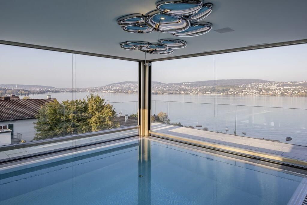 Luxury descending windows to create an open space for a pool area in closed position
