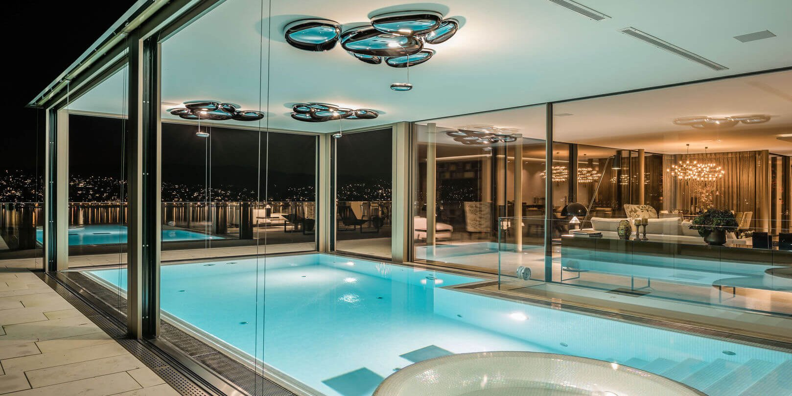 Luxury windows in swimming pool area at night
